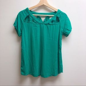 Francesca's small cut out top shirt